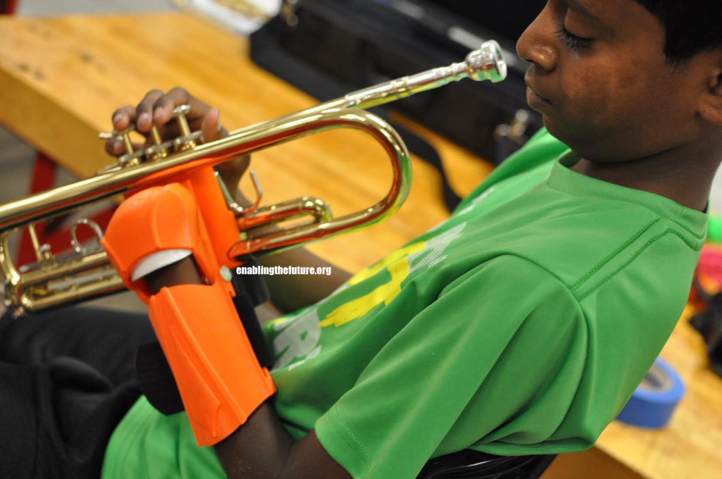 Karuna tests out his new trumpet holding device!
